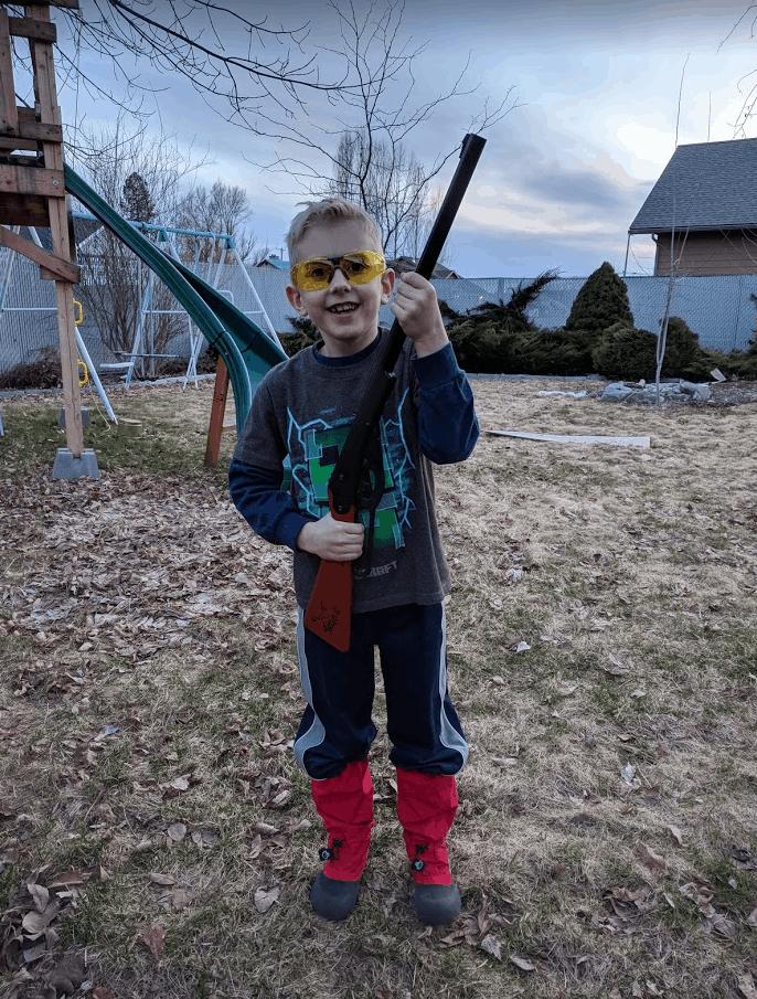 Eli holding Daisy Buck BB Gun