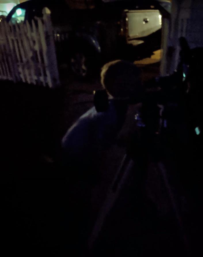 Eli looking through telescope