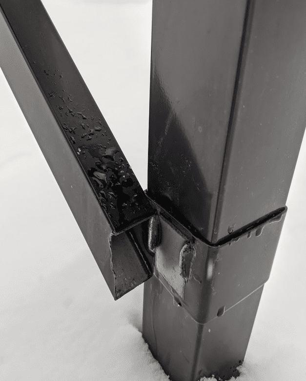 Broken mailbox arm after plow hit