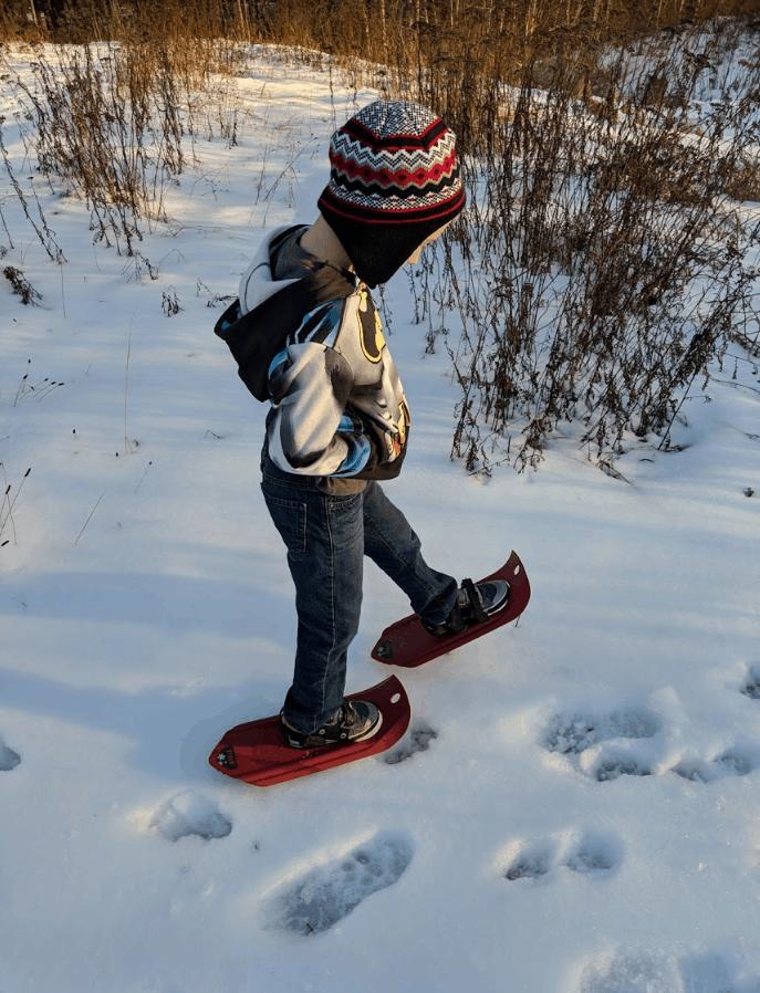 Eli walking in Snow Shoes
